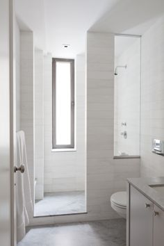 Narrow Bathroom with narrow window overlooking shower