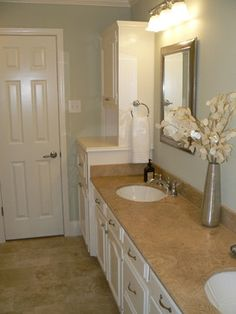 Master Bathroom: Tan Counter, White Cabinets, Sea Blue paint, white and silver accents