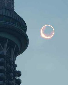 An annular eclipse is seen beside the Tokyo Sky Tree tower in Tokyo's Sumida Ward at 7:34 a.m. on May 21. This composite photo was created using different exposure levels taken at the same place. (Satoru Sekiguchi)