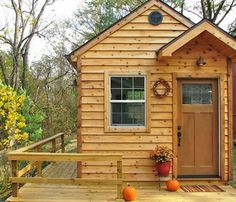 tiny cabin with wrap-around porch