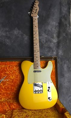 Just arrived and only one in stock, ready to ship! The Danny Gatton Signature Telecaster guitar is based on Gatton's heavily customized '50s Telecaster. The neck is a superb burled maple with tons of beautiful Birdseye an burl! The cubic zirconium side markers will reflect light even on the dark...