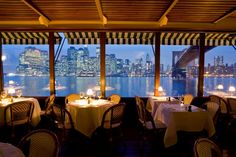 """The River Cafe; New York, N.Y. """"Best View"""" For the most romantic view of """"The City,"""" it's best to think not of height, but of orientation. The River Café's unique perspective at the base of the Brooklyn Bridge provides an unsurpassed silhouette of lower Manhattan."""