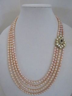 Multi Strand Fresh water Pearl Necklace by ZainabshCollection on Etsy Ruby Jewelry, Bead Jewellery, Beaded Jewelry, Beaded Necklace, Layered Necklace, Gold Jewelry, Pearl Necklace Designs, Pearl Necklace Set, Pearl Set