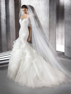 A mermaid dress is similar to a trumpet dress or a fit and flare dress but give more volume and drama to the overall silhouette of the wedding dress. As its name implies, the dress hugs the bride's…