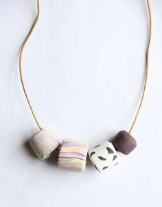 Dana  Polymer Clay Bead Marbled Pastel Black White Cord by jjjasbo