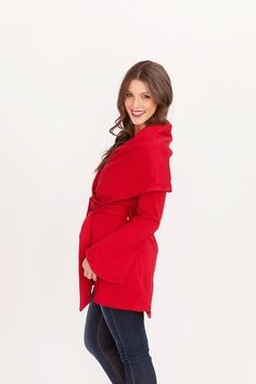 Wide lapel coat in red with tie at waist.