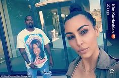 Lurker: Kanye stayed uncharacteristically quiet throughout, standing broodily silent in the background at one stage in one of Kim's selfies