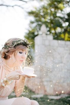 Cute for a wedding photo with the bride blowing fairy dust on the flower girl!