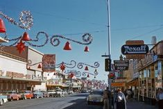 "Vintage Las Vegas Christmas Photo ~ ""Looking up Fremont Street in Las Vegas from South Second toward the Fremont Casino & Carnival Room around Christmas Kodachrome slide taken by my late father with a Kodak Retina camera."