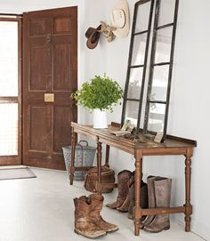 Great use of salvaged windows in this lake house's entryway. #repurposing