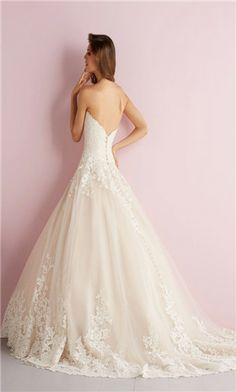 I love the hint of rose color in this lacy ball gown wedding dress that yet still has a certain flow to it.