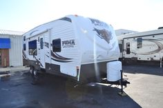"""http://www.bigdaddyrvs.com/inventory/271485/New-2013-Palomino-Puma-Unleashed-27_SBU.aspx  Palomino Puma 27-SBU Unleashed Toy Hauler w/Rear 7' Ramp Door w/Spring Assist to 13'6"""" Up to 14'4"""" Cargo Area, 2 Sleeper Sofas in Cargo Area w/Table Between, 2 Lounge Chairs w/Dinette Table Between, Dbl. Kitchen Sink, 3 Burner Range, Ent. Center/Refrigerator, Pantry, Tub/Shower, Toilet & Vanity w/Sink, Front Queen Bed w/Nightstand/Shirt Closet, TV Shelf, Exterior Storage & More!"""