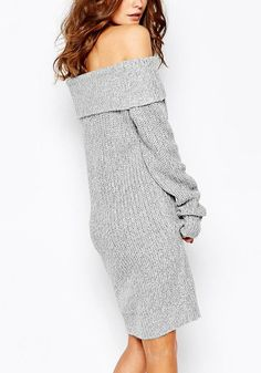 Right angled shot of model in a grey off-shoulder knit dress
