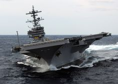 The aircraft carrier USS George H.W. Bush, turning hard.