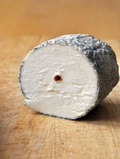 ✿ڿڰۣ   Sainte Maure de Touraine is a French  unpasteurized cheese made from full fat goat's milk. It has the form of a small log, around 16–17 cm in length, and weighs at least 250 g. It is white and soft under a greyish mouldy rind. It has a straw through its centre, marked by the AOC seal and a number indicating the producer. The straw is used, in the making, to keep the roll together. The finished cheese has 45% milkfat. It has a balanced tang with walnut notes and a lemony finish.