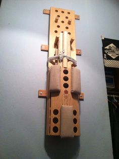 Peg board with removable Wing Chun practice dummy.