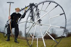 """Bicycle designer Dieter """"Didi"""" Senft presents his latest bicycle invention, the so-called """"111-twelve-teeth-rake-bicycle"""" in Storkow, Germany, 12 March 2012. The bicycle consists of 111 garden rakes and is fully functional but cannot be used for raking. Senft who is known as the """"Tour-Devil"""" at the Tour de France has been inventing curious bicycles for many years."""