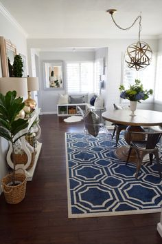 A bold area rug will create the perfect centerpiece in your dining room.  HomeGoods Sponsored Pin.