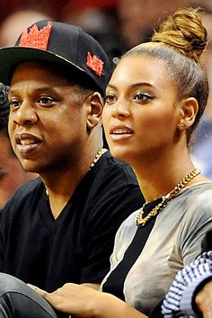 Pictured here with her husband Jay-Z at a local Basketball game she has her hair casually scraped back into a neat bun. Beyonce