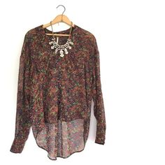 """Free People floral blouse Gorgeous floral Free People blouse. Size small. Oversize, button down, and high low style. In fabulous condition! One *tiny* """"line"""" by the right side of the collar. Not at noticeable, I just wanted to mention. Otherwise mint condition! 22 inch bust. 21 inch high. 28 inch low. Free People Tops Blouses"""