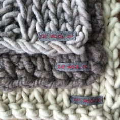 Essex yarn dyed linen sewn into Fat Wool Co product labels.
