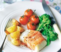 Cod wrapped in prosciutto with potatoes, broccoli and tomatoes