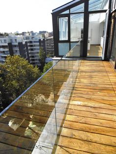 An outside view of Abbey Glass aluminium windows and doors and frameless balustrade looking fab on London penthouse balcony