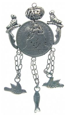 AChachal is a necklace made and worn by indigenous peoples of Guatemalan. Fashioned from a large silver Guatemalan peso coin, this example includes milagro charms of fish, doves, masks, and Quetzal birds, the Guatemalan national bird.