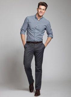 Plaid button up, dark gray slacks, and dark colored shoes.