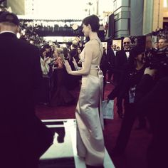 Anne Hathaway steps up to the Oscars preshow stage Photo by The Academy Instagram