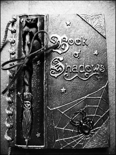 Book of Shadows...every good witch should have one.  I especially like the kitty.