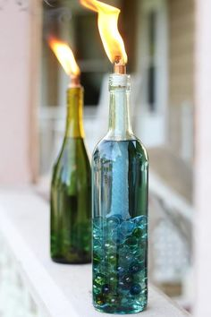 Cookouts are one of the best parts of summer, but dealing with pesky mosquitoes isn't. Ease any bug-worries by turning empty bottles of wine into citronella candles.