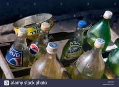 Glass And Plastic Soda Bottles Filled With Gasoline Are For Sale On A Stock…