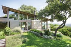 On a hill overlooking downtown Austin, Lake|Flato Architects and designer Terry Hunziker collaborated on an airy minimalist retreat inventively anchored to its magnificent site.
