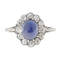 High Dome Natural Cornflower Cabochon Sapphire Diamond Platinum Ring | From a unique collection of vintage engagement rings at https://www.1stdibs.com/jewelry/rings/engagement-rings/