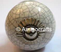 http://www.amigocrafts.com/ProductDetail.aspx?m=0&c=0&sc=22&q=80&tag=White%20Crackle%20Round%20Ceramic%20Knob