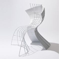 eva chou architecturally engineers warped surfaces for R shell chair