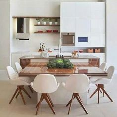 do dia: ilha do chef White Modern kitchen with integrated dining.White Modern kitchen with integrated dining. Kitchen Interior, New Kitchen, Kitchen Dining, Kitchen Decor, Kitchen Island, Kitchen Layout, Kitchen Modern, Kitchen Ideas, Kitchen Wood