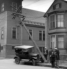 Vintage photo of vehicle and a power pole collision.