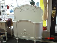 Sold. Shabby Chic Vintage Painted Furniture: Beds.  This could work to hold rolls of fabric.