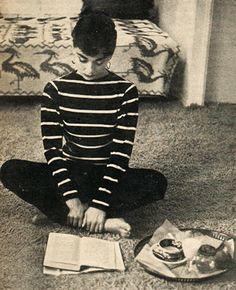 Audrey Hepburn reading. Better eyesight than me, and a great breton stripe