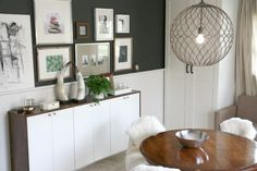 love the deep gray grey colored walls with the white horizontal board under the chair rail. love the light fixture and love the fauxdenza!