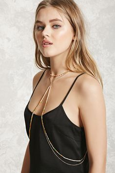 A chain-link body chain featuring a beaded design, a lobster clasp closure around the neckline, and a draped front.