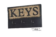 $15.00 This item comes ready to hang. It is handmade by a skilled woodworker from recycled wood, hand-painted black with hand stenciled lettering on a natural burlap fabric. It has 3 hooks that are very strong and sturdy. This key rack will help keep you organized and ready to go, so it is a vital piece of home decor for everyone! 9 inches wide and 5.5 inches high