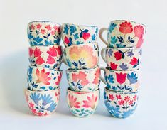 I need these vibrant teacups in my life! This style certainly spices up traditional folk art. #modernfolk #floralfolkart #folkteacups #brightfolk #scandistyle