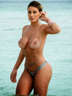 Here is Andressa Urach topless after stripping off her bikini top while she was on a beach in Miami. Andressa Urach is Brazilian and the Miss Bumbum Runner-Up contestant so her skimpy bikini exposing her ass should come as not a surprise