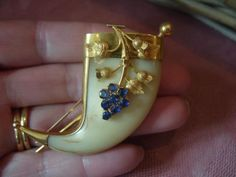 Victorian tiger claw brooch with sapphire and gold detail