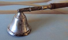 Vintage candle snuffer. Would look great next to the candle on my nightstand!