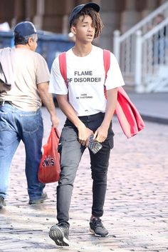 Jaden Smith wearing Gucci GG Caleido iPhone 6 case, Adidas Ultra Boost 3M Sneakers