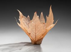 Kay Sekimachi  - leaf bowls. Real leaves, with Kozo paper, watercolor paint, and Krylon coating.  Not quite as fragile as they look.